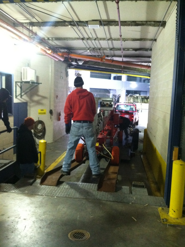 The crew at Central Ohio window cleaners, Globe Window Cleaning, carefully unloading the Denka atrium lift.