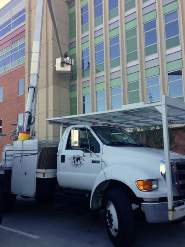 Our bucket truck in use, cleaning windows at the university - McCampbell Hall at OSU